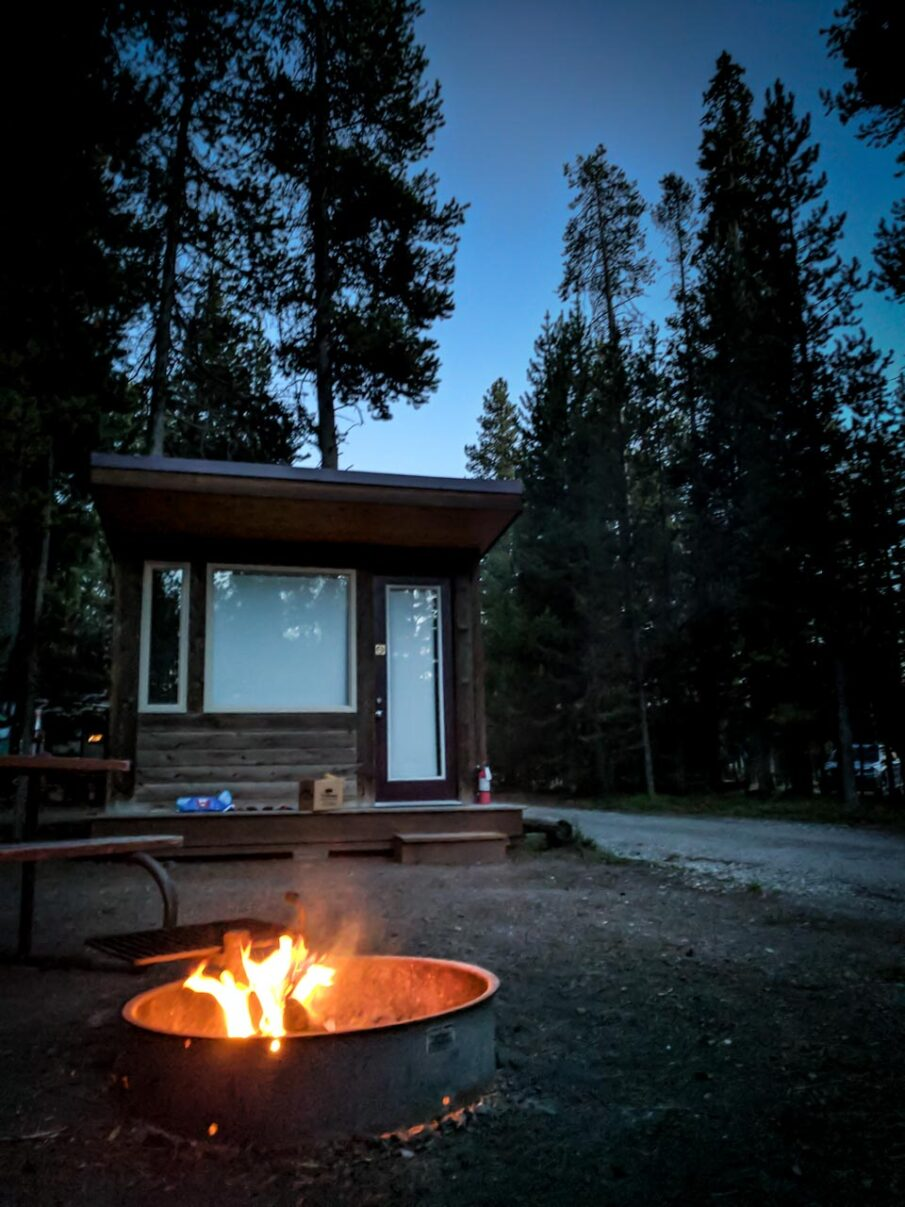 Campers cabin with fire-pit at Headwaters Lodge, Grand Teton National Park