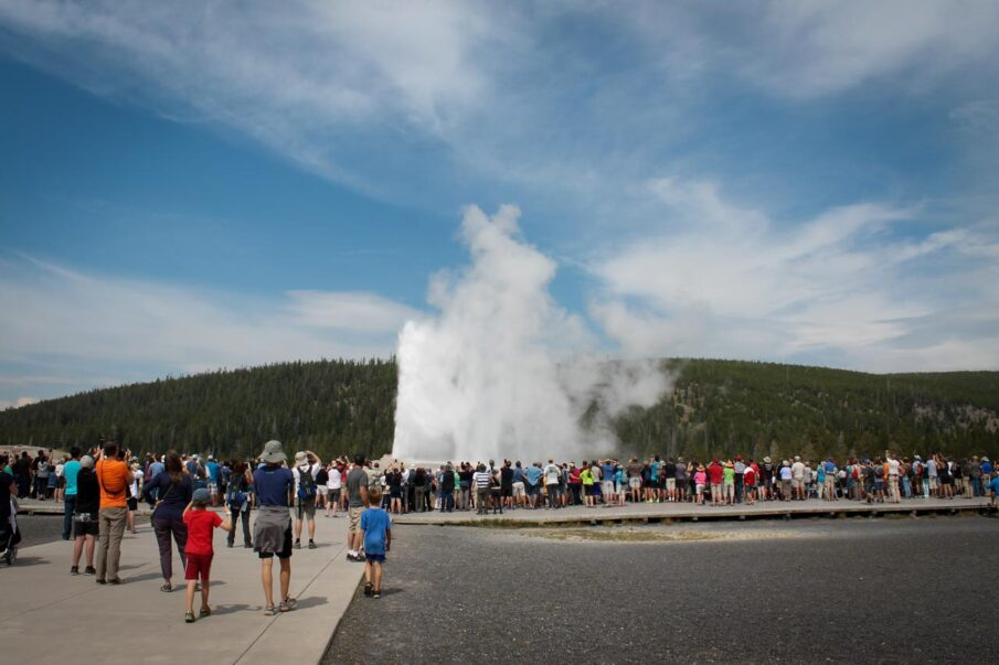 Hoards of people at Old Faithful in Yellowstone National Park